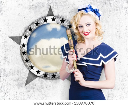 Attractive pinup girl in nautical uniform holding telescope beside sea port window when on a pin-up travel cruise. Nautical sightseeing - stock photo