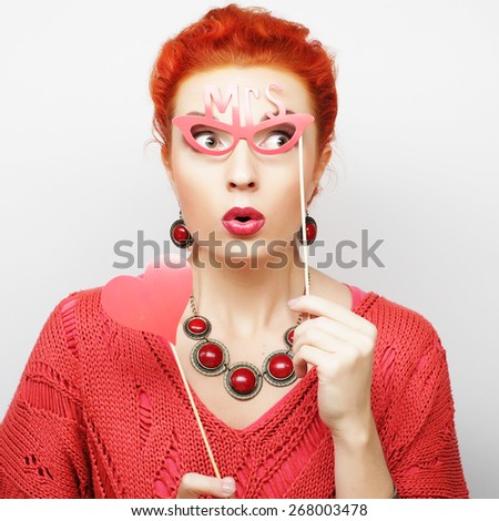 Attractive playful young woman ready for party - falce lips and glasses
