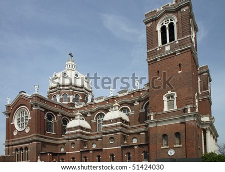 Attractive Polish cathedral style architecture with dome and angels