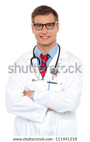 Attractive portrait of confident male doctor posing with arms crossed - stock photo