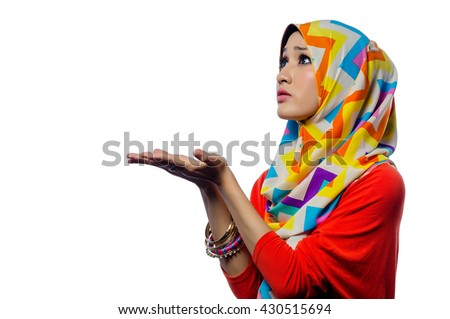 Attractive portrait of young muslim woman with hands gesture - stock photo