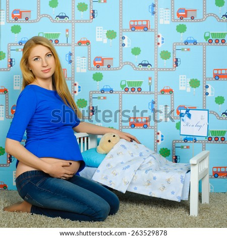 attractive pregnant woman bedding toy  - stock photo