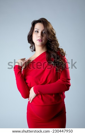 Attractive pregnant woman posing at camera - stock photo