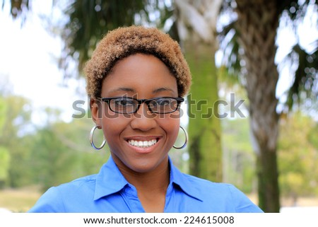 Attractive Professional African American Business Woman Person Black Hair Smiling and Wearing Glasses - stock photo