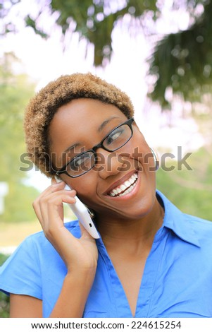 Attractive Professional African American Business Woman Person Black Hair Wearing Glasses Talking on the Phone - stock photo