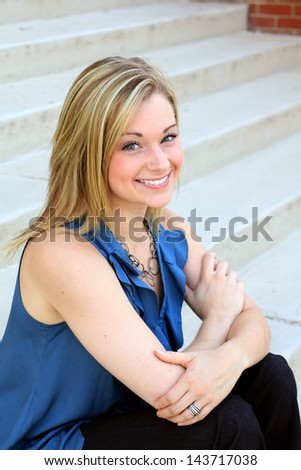 Attractive Professional Blonde Business Woman Smiling and Looking at the Camera Arms Crossed - stock photo
