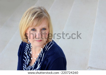 Attractive Professional Business Person Blonde Caucasian Woman Middle Age Mother - stock photo