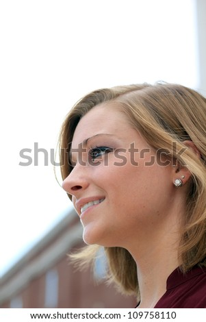 Attractive Professional Business Woman Looking Up at the Sky, Smiling Side Profile - stock photo