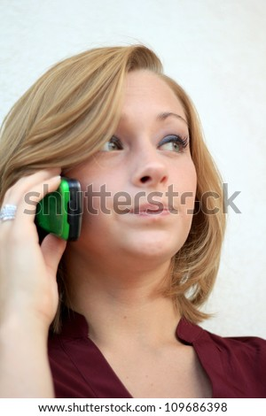 Attractive Professional Business Woman On the Phone While Looking Forward - stock photo