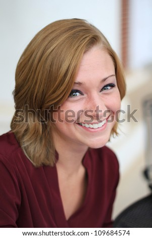 Attractive Professional Business Woman Smiling Looking at the Camera