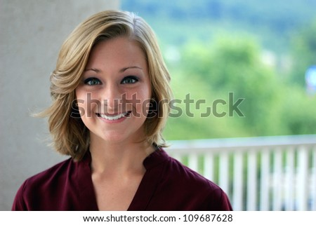 Attractive Professional Business Woman Smiling Looking at the Camera - stock photo