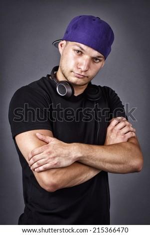 Attractive rapper with headphones - stock photo