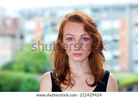 attractive red hair freckled woman portrait outside - stock photo