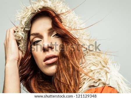 Attractive red hair woman. Studio portrait.