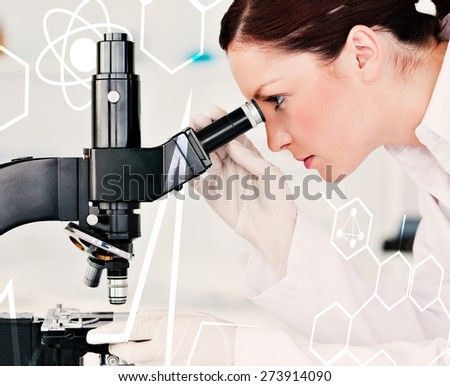 Attractive redhaired scientist looking through a microscope against science and medical graphic - stock photo