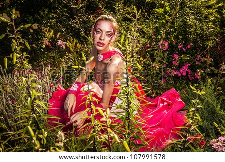 Attractive romantic woman on beautiful dress pose outdoor.