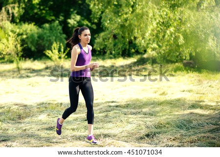 Attractive running young woman outdoor. Workout in the park, forest, nature. Sport