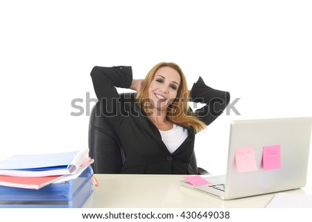 attractive 40s blond businesswoman working at office laptop computer sitting on the desk relaxed and smiling happy as if thinking of vacation isolated on white background business success concept - stock photo