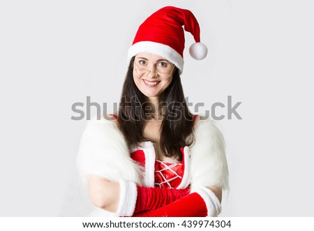 Attractive Santa girl smiling portrait. Christmas background - stock photo
