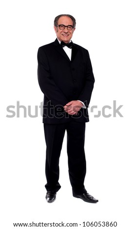 Attractive senior man posing in tuxedo isolated over white background - stock photo