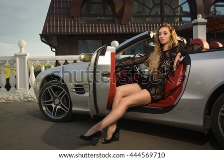 Attractive sensual fashionable woman in a car