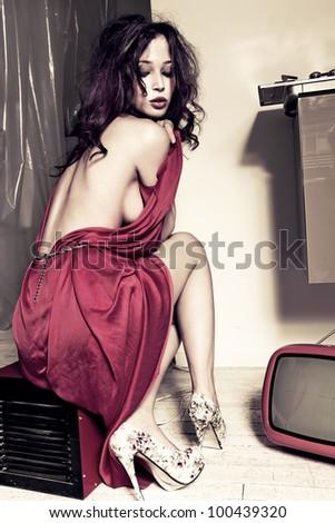 attractive sensual woman in retro style indoor shot full body shot - stock photo