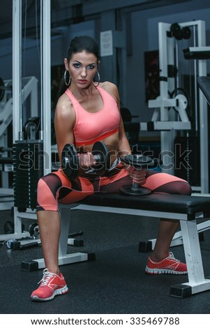 Attractive sexy athlete in the gym - stock photo