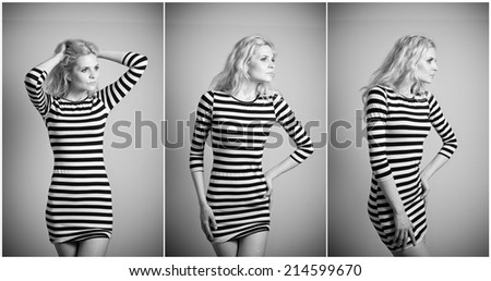 Attractive sexy blonde in black and white tight fit dress posing provocatively indoor. Portrait of sensual woman in classic boudoir scene against a wall. Beautiful fair hair female, indoor shot. - stock photo