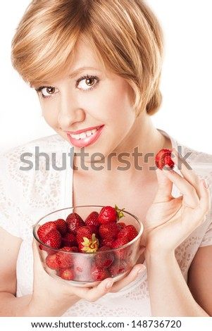 attractive sexy blonde with strawberries. studio
