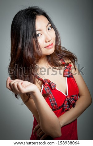Attractive sexy santa claus asian girl in her 20s isolated on a grey  background - stock photo