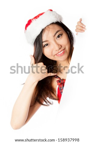 Attractive sexy santa claus asian girl in her 20s isolated on a white background - stock photo