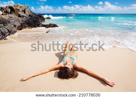 Attractive sexy woman relaxing on beautiful tropical beach - stock photo