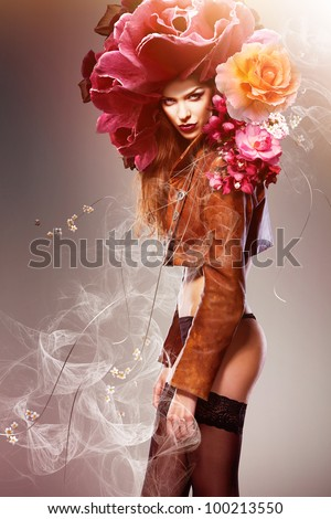 attractive sexy woman with big flowers - stock photo