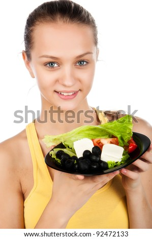 attractive sexy young woman eat healthy vegetarian salad, girl holding a plate of greek salad, smiled young caucasian woman on diet and loss weight, isolated on white background
