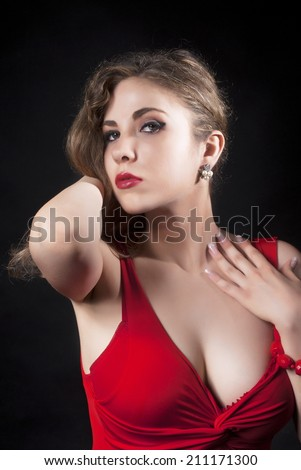 Attractive Sexy  Young Woman In Red Dress Over Black Background - stock photo