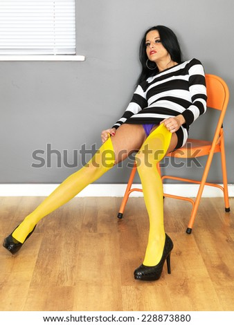 Attractive Sexy Young Woman Wearing a Mini Dress and Yellow Stockings - stock photo