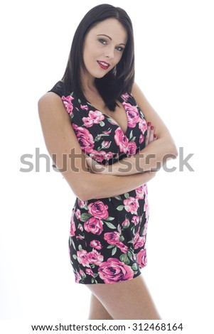 Attractive Sexy Young Woman Wearing a Short Floral Playsuit Shot Against A White Background  - stock photo