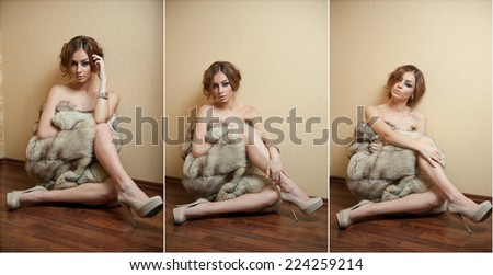 Attractive sexy young woman wrapped in a fur coat sitting on the floor in hotel room. Sensual redhead female being sad and daydreaming near a wall. Beautiful girl only in fur coat and high heels - stock photo