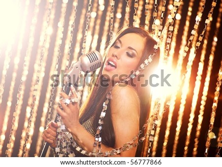Attractive singer on the stage - stock photo