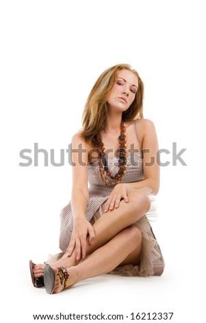 Attractive sitting girl - stock photo