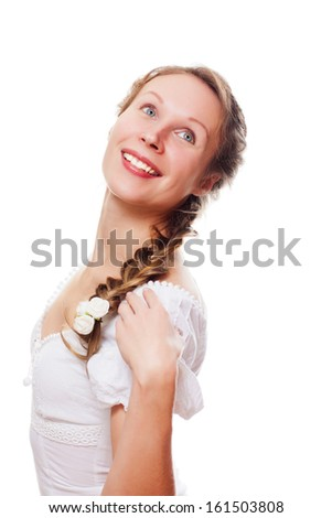 Attractive slender woman in simple white dress on light background - stock photo