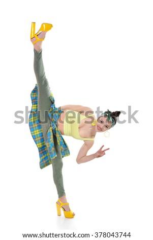 Attractive slim teen girl posing in studio. Full length portrait of young fashion woman. Fitness dancing girl. Splits. - stock photo