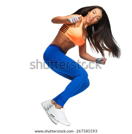 Attractive slim woman with dark long hair in a jump. Isolated on white