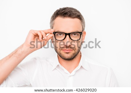 Attractive smart successful man touching his eyewear - stock photo