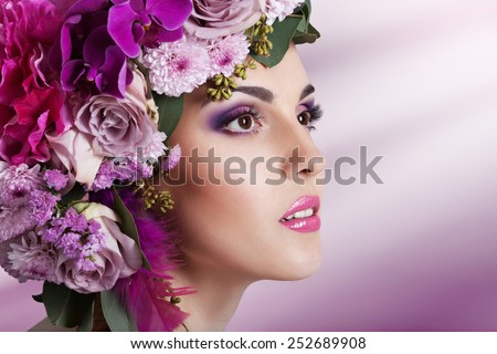 Attractive Smiling Beautiful Girl With Flowers Crown. Perfect Soft Skin. Skincare concept. Bodycare Spa.  - stock photo