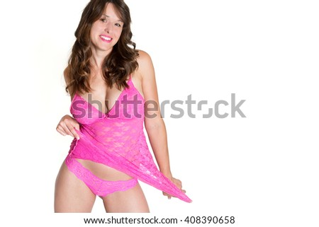 Attractive smiling brunette woman wearing pink top and panties, isolated in front of white studio background, photo with copy space on the right side of the image