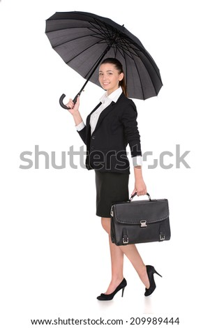 Attractive smiling business woman holding up a black portfolio case and an umbrella on white background - stock photo