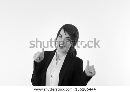 Attractive Smiling businesswoman giving the thumbs up  - stock photo