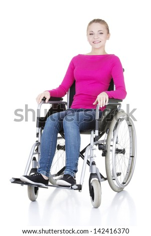 Attractive smiling disabled woman sitting in a wheel chair isolated on white - stock photo
