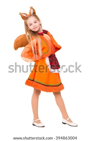 Attractive smiling girl in a squirrel suite. Isolated on white